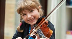 Happy note: playing an instrument like a violin can boost confidence