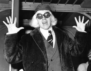 Jimmy Savile arriving in London, on his way to Buckingham Palace