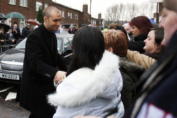 Calum Best shakes hands with well-wishers as George Best's funeral cortege leaves the Best family home
