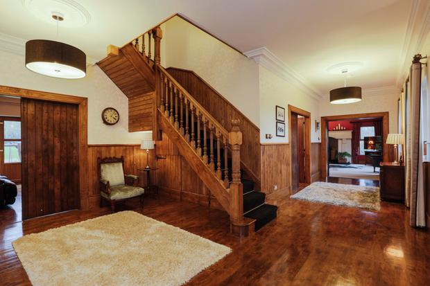 Natural wood has been used in the entrance hall for floor, stairs and walls