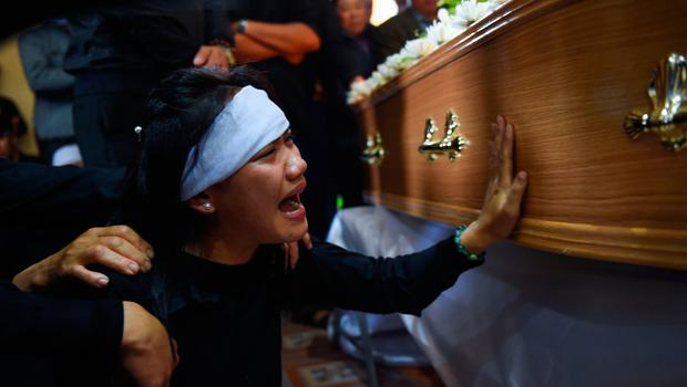 A grief-stricken woman at the funeral