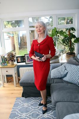 Striking style: Jane Holohan in her two-piece red suit