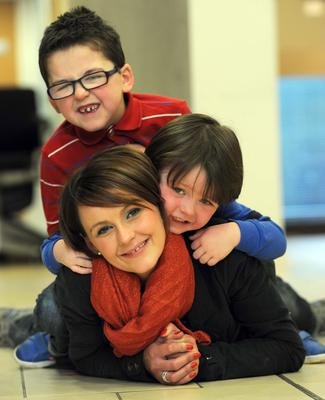 Devoted mum: Jane Vaugh with her sons Eoin and Conall