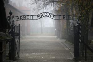 Gates of Hell: the infamous German inscription that reads 'Work Sets You Free' at the main entrance of Auschwitz