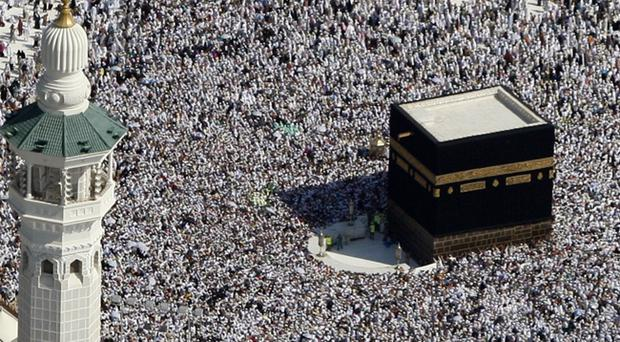 Tens of thousands of Muslim pilgrims moving around the Kaaba, the black cube seen at center, inside the Grand Mosque, during the annual Hajj in Mecca, Saudi Arabia