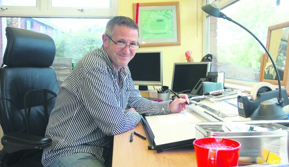 Belfast Telegraph cartoonist, Stevie Lee pictured in his studio at his home in Saintfield