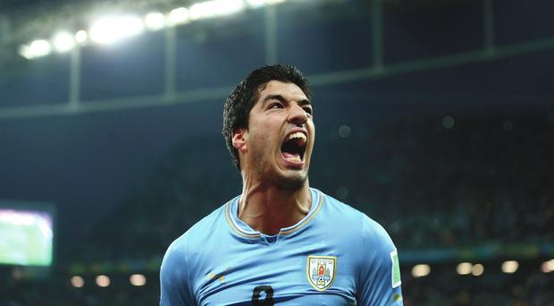 Eat it: Luis Suarez's bite left a lasting impression