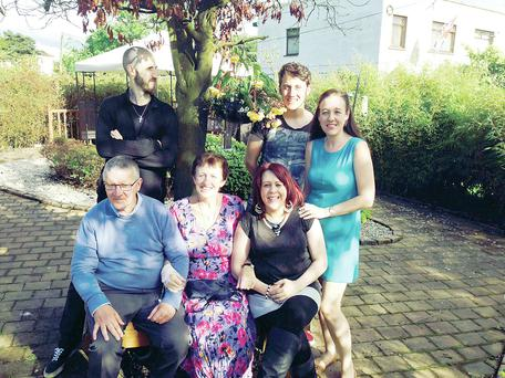 Special time: Una (centre) at the NI Hospice last week with (seated, from left) husband Felix, and daughter Grainne and (standing, from left) sons Phillip and Nathan and daughter Lisa