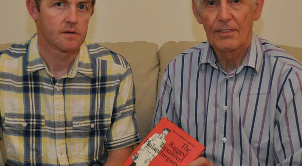 Picture perfect: Bill Kirk (right), with son Brendan, holds his favourite book, The Ragged Trousered Philanthropists