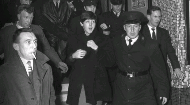 The Beatles are flanked by RUC officers on their visit to Belfast