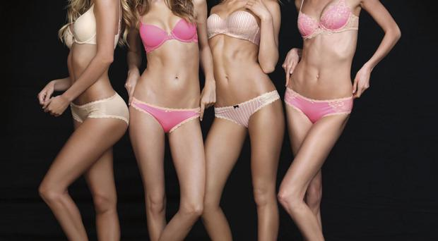 Body language: Victoria's Secret models display the US firm's new range of lingerie