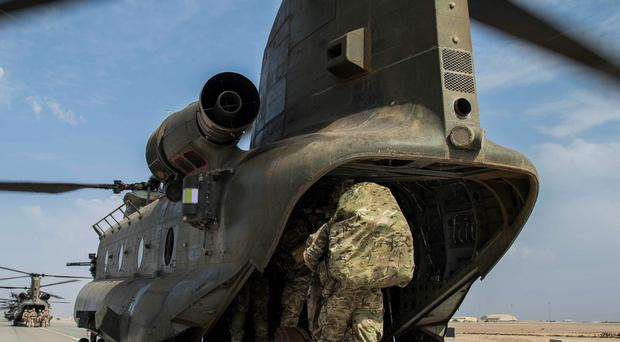 Wing Commander Matt Radnall, Officer Commanding 7 Force Protection Wing, boards the last Chinook helicopter - the last British serviceman to leave Camp Bastion in Helmand Province, Afghanistan earlier this week