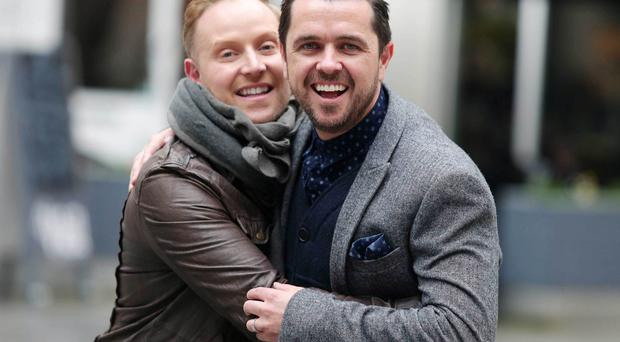 Close pals: Pete Snodden (right) and Marcus Hunter-Neill give each other a man hug at St Anne's Square in Belfast city centre