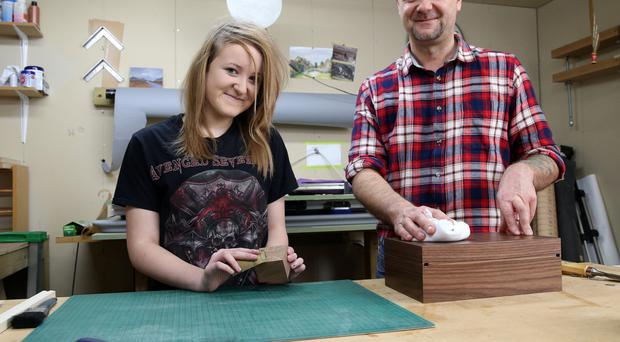 Ian Hawthorne with daughter Zoe in his Carnmoney workshop