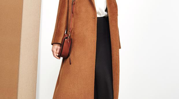 Hat, £65, coat, £599, blouse, £180, skirt, £150, bag, £225
