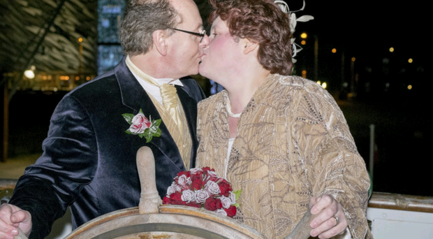 Love boat: Karen and Jim McCurry share a kiss on board the SS Nomadic to celebrate their 25th wedding anniversary