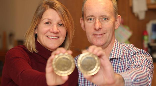 Record achievement: Gillian and Gary with their 100 Marathon Medals