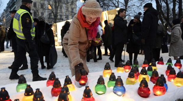 Holocaust reminder: candles, like these in Sweden, will be lit to commemorate the liberation of Auschwitz