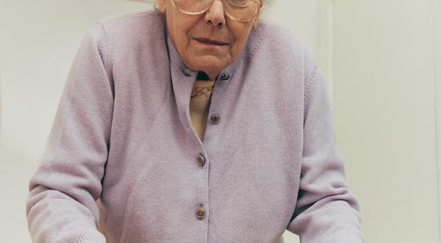 In the frame: the elderly are often the first to suffer during budget cuts. Picture posed