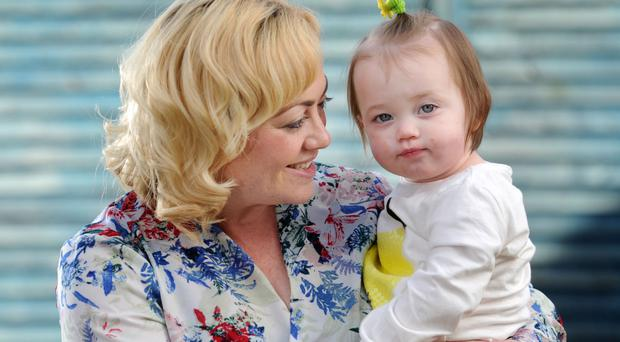 Nappy days: Clare Beswick with her daughter Erin