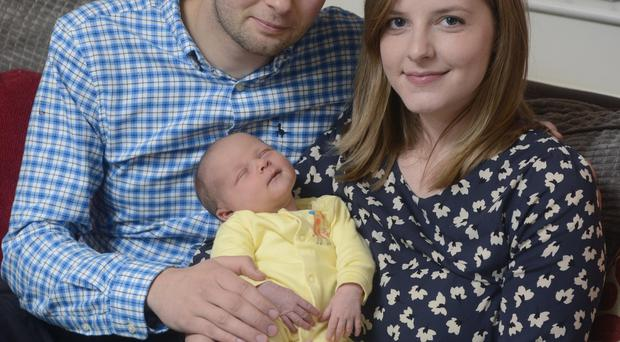 Under fire: Daniel McArthur from Ashers Bakery with his wife Amy and their daughter Elia