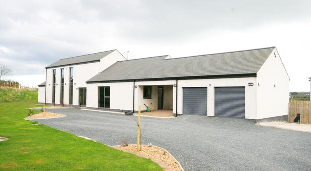 This stunning contemporary home in Hillsborough has been architecturally designed by the vendors to an exceptional specification