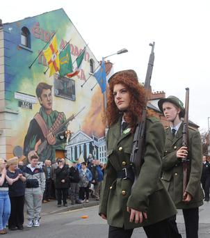 Marching on: the Easter Rising parade makes its way along the Falls Road in Belfast last week