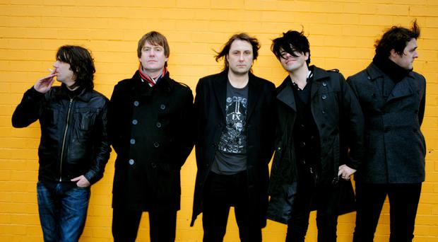 Famous five: The Charlatans with Jon Brookes (centre) in their line-up