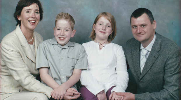 Proud parents: a treasured family photograph of James and Eimear MacSorley with their mum and dad, Anne and Michael