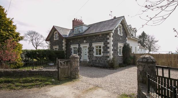 The wonderful grade two listed cottage sits in a pleasant location just over a mile from Hillsborough village centre