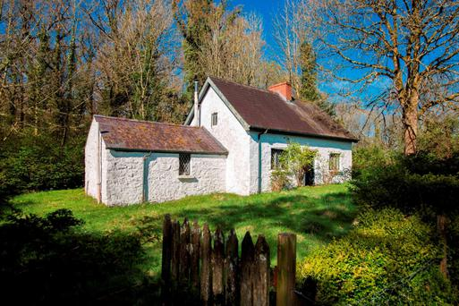 The secluded, traditional Irish cottage sits on an unspoilt peninsula, which extends to four acres