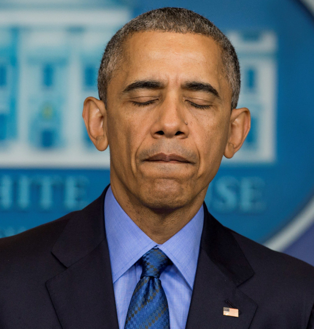 Tragic moment: US President Barack Obama reflects on the shooting dead of nine people