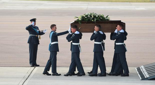 Tragic sight: The bodies of British nationals killed in the Tunisia terror attack are returned home