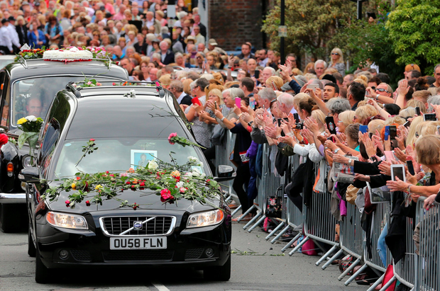 Thousands lined the streets leading to St Mary's Church in the affluent Liverpool suburb of Woolton where the funeral of Cilla Black took place