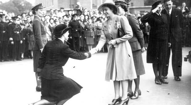 Princess Elizabeth shakes hands with Miss MO King of the WRNS at Queen's University during a royal visit to Belfast in 1945