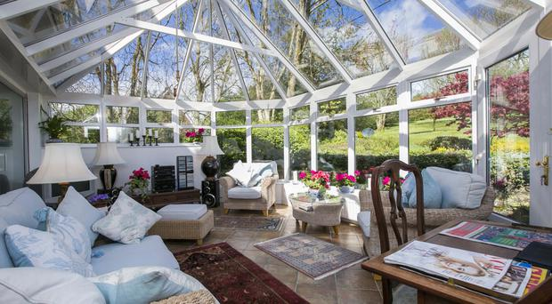 The light and bright conservatory offers the perfect place to relax in the summer
