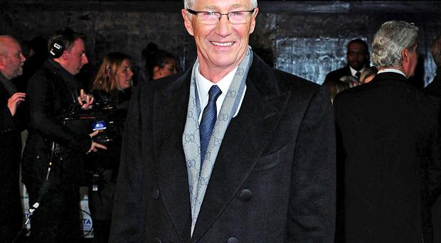 Still standing: Paul O'Grady has immersed himself in work following the loss of Cilla Black and Jackie Collins