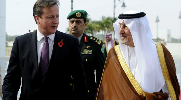 Thick as thieves: Prince Khalid bin Faisal bin Abdulaziz with David Cameron