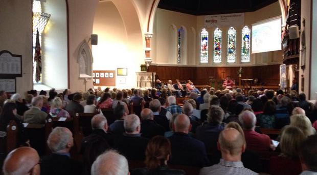 Divisive issue: one of the controversial red heart flags (top left) which angered Church of Ireland parishioners