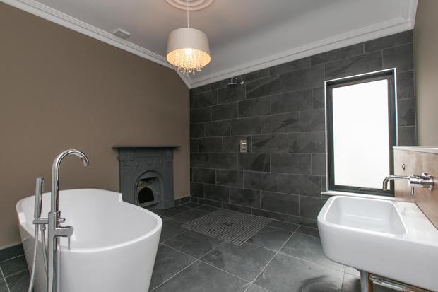 Bathroom with freestanding bath and infinity tap walk in shower