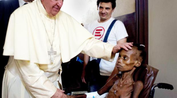 Gently touching the boy's forehead and taking his hand, the Pope blessed the young patient