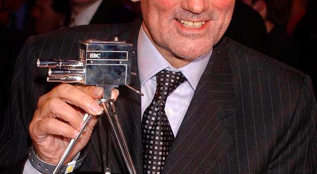 Fitting tribute: George Best with his Lifetime Achievement award