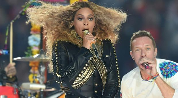 Controversial show: Beyonce with Coldplay's Chris Martin during the Super Bowl half-time performance