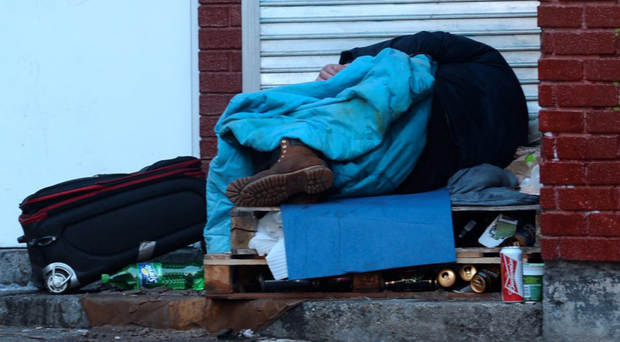 Roughing it: the streets are littered with young men in sleeping bags