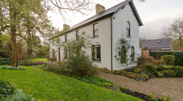 Originally an old stone cottage, the property is now an extended and elegant detached home with generous gardens