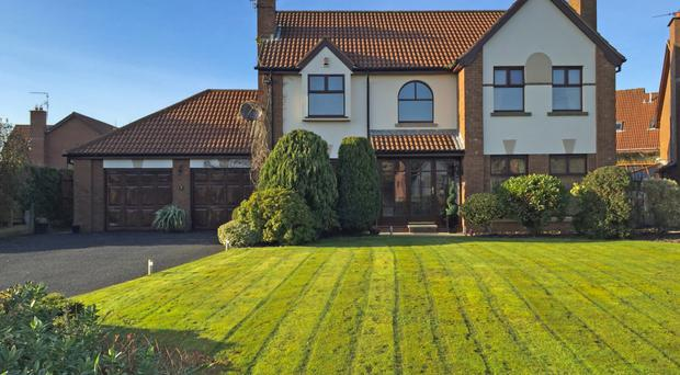 This gorgeous family home in Newtownards boasts a double garage and lawns to the front and rear