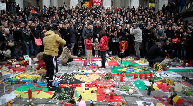 Shocking events: people observe a one-minute silence in honour of the victims of the terror attacks in Brussels