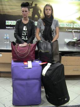 Bang to rights: Michaella McCollum and Melissa Reid with their luggage after being detained at the airport in Lima, Peru