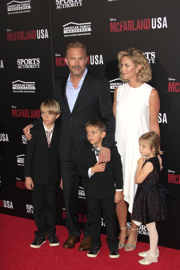 First family: Kevin Costner with his wife Christine Baumgartner and their children at the LA premiere of his 2015 McFarland. Below, Costner as psychopathic inmate Jericho Stewart in Criminal
