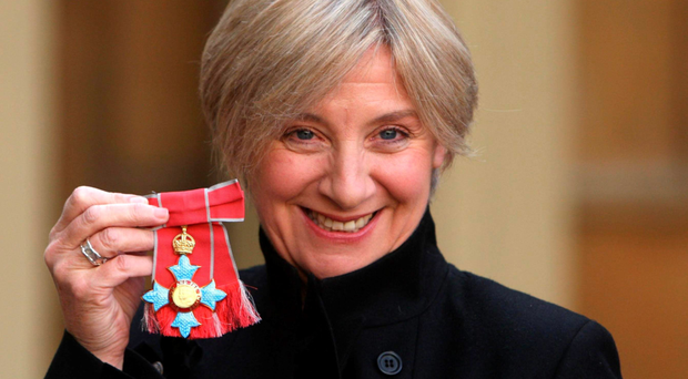 Victorious Wood: the comedian receiving her CBE at Buckingham Palace. Her work was a triumph, turning the banal into clever entertainment